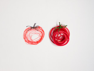Two conceptual tomatoes