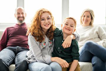 A Beautiful happy family having fun on sofa at home