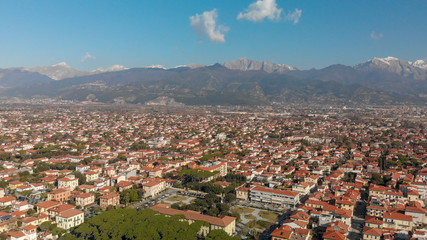 Aerial panoramic view of Forte dei Marmi skyline on a sunny winter morning, drone perspective