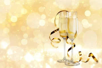 Glasses of champagne with curly ribbon on bright background
