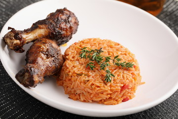 Photo sur cadre textile Assortiment Nigerian Jollof Rice with chicken thigh