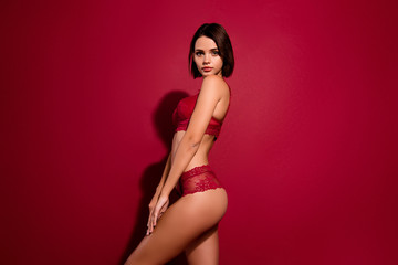 Profile side view portrait of nice-looking cute sweet winsome attractive lovely slim fit thin sporty sportive shape figure girlfriend posing isolated over burgundy maroon background