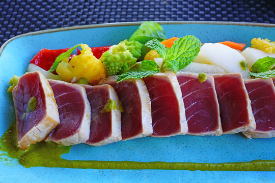 Platter of seared fresh tuna fish with fruit salsa