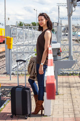 pretty woman near barrier at the border