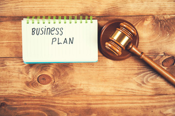 business plan text  on notepad with judge