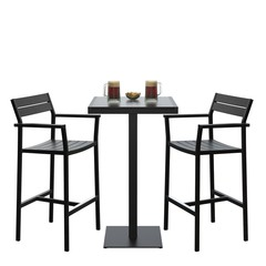 Two modern bar stools with high table and beer on it