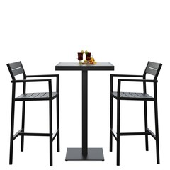 Two modern bar stools with high table and mulled whine on it