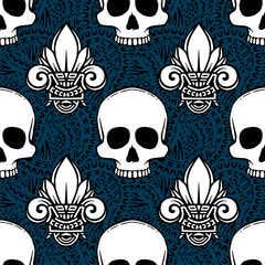 Seamless ethnic pattern with lotus and skulls image. Handmade. Vector illustration.