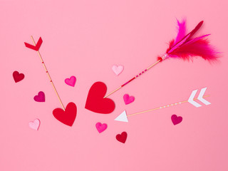 beautiful pink valentine background with love arrows and many hearts