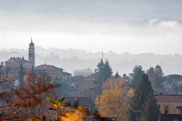 Panoramic view of a village from the woods in its autumn garment