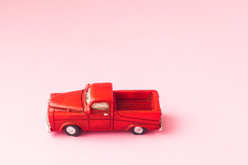 toy car model red on a pink background. selective focus