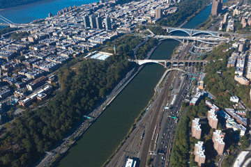 Bridges between Manhattan and the Bronx in New York NYC in USA. Upper Manhattan. Harlem river. Aerial helicopter view