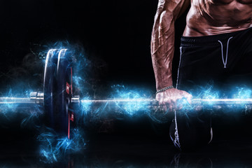 Closeup photo of strong muscular bodybuilder athletic man pumping up muscles with barbell on black background. Workout energy bodybuilding concept. Copy space for sport nutrition ads.