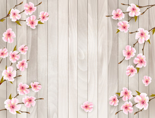 Wall Mural - Cherry branch with a pink flowers on wooden background. Vector