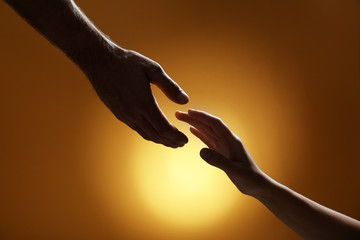 Man reaching for woman's hand on color background, closeup. Help and support concept Wall mural