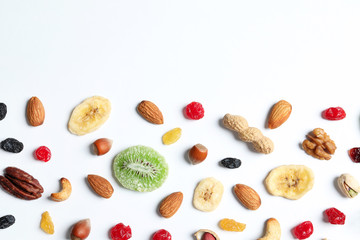 Flat lay composition of different dried fruits and nuts on white background. Space for text