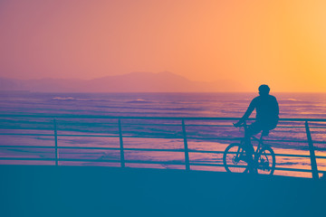 person watching the sunset on the bike
