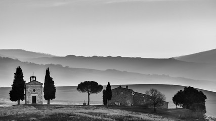 The chapel of the Madonna di Vitaleta in black and white at the first light of the day, San Quirico d'Orcia, Siena, Tuscany, Italy