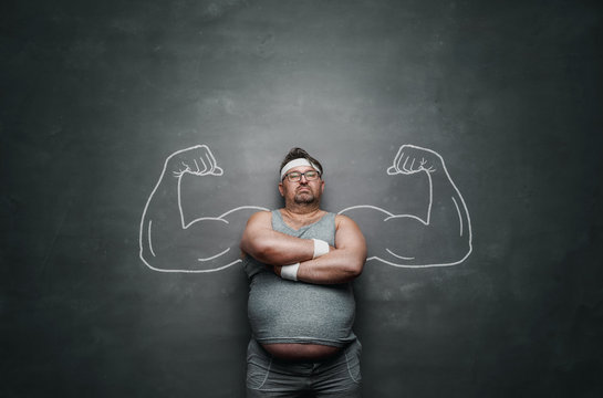 Funny sports nerd with huge muscle arms drawn on the gray background with copy space