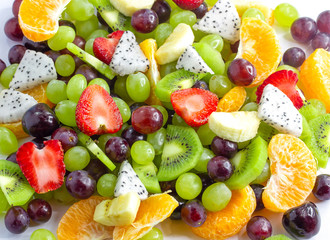 Healthy fresh fruit salad on white background. Top view.Fruit background