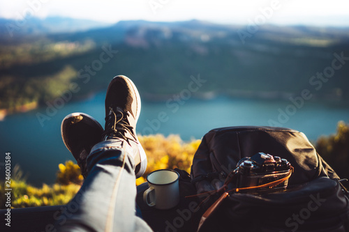 Wall mural view trekking feet tourist backpack photo camera in auto on background panoramic landscape mountain, vacation concept, foot photograph hiking relax in auto, photographer enjoy trip holiday, mockup