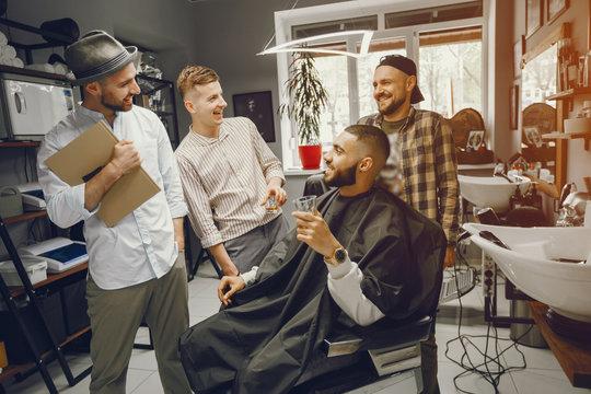 Friends have fun in barbershop