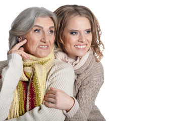 Happy Senior woman with daughter on white background