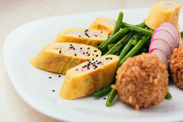 Japanese omelette tamagoyaki in a plate served with rice
