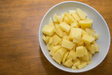Bowl with pieces of potato.