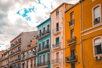 colorful houses with dramatic sky