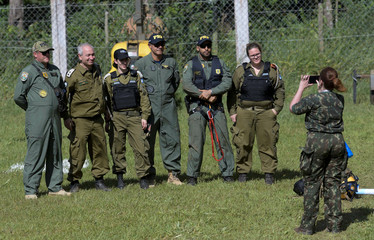 Israeli military personnel and Brazilian federal police officers pose for a picture, after a tailings dam owned by Brazilian mining company Vale SA collapsed, in Brumadinho