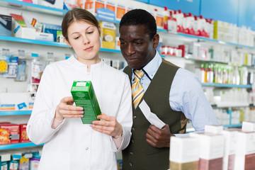 explaining prescribed medicine to  man