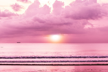 Colorful tropical sunset, sea with sunset, beach view wallpaper. Beautiful cloudscape over the sea. Toned in warm pink colors. Bali, Indonesia.