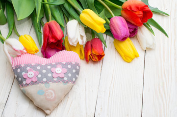 bouquet of tulips with a gift on rustic wooden board, womens day, valentines day,
