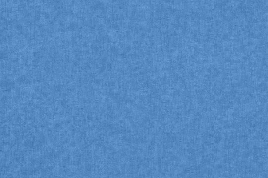 Texture of a blue book cover made of textile canvas fabric