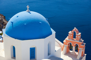 View over caldera and typical blue house at Santorin, Greece