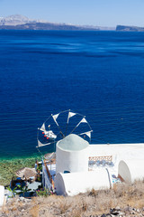 View over windmill and caldera, Santorin, Greece