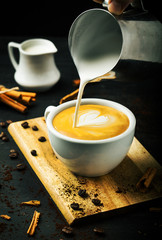 Delicious coffee with milk and cinnamon