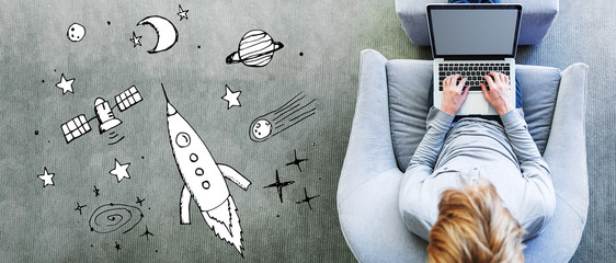 Dream of space and rocket with man using a laptop in a modern gray chair