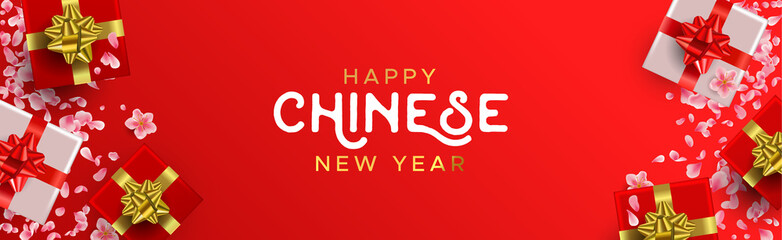 Chinese New Year banner of red gifts and flowers