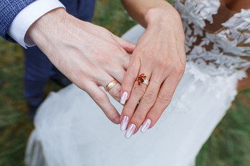 hands are newly married with golden wedding rings.