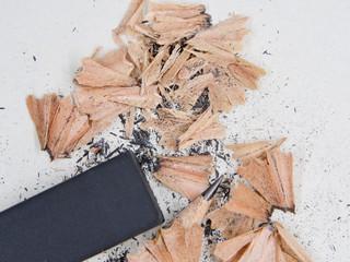 Pencils and black eraser, debris on grey sketch notepad background