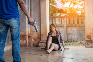 Man holds gun to attack Beautiful woman in an abandoned building