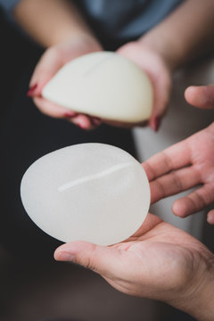 Plastic surgeon and patient discuss choice of breast implants after mastectomy or for breast augmentation.