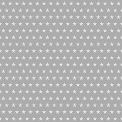 Abstract seamless pattern of small stars in white and gray colors