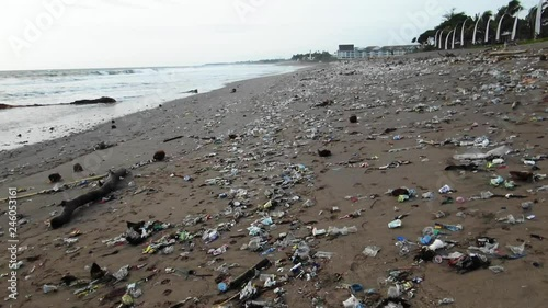 Walking Over Plastic Trash On The Beach Ecological Disaster In Bali