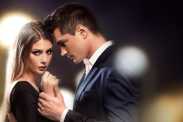 Obraz Young beautiful couple posing. - fototapety do salonu