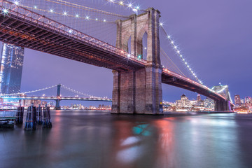 View on Brooklyn Bridge and Manhattan Bridge from East River at night  with long exposure