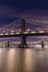 View on Manhattan bridge and Brooklyn bridge form east river at night with long exposure