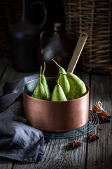 Ingredients for mulled wine with pears and cinnamon